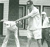 Bud Heyman (foreground), along with golfing partners Joe Dolan (left) and Spike Berg, stretch before teeing off at the American Legion Golf Course.